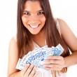 Portrait of a happy woman with a fan of Euros currency notes - Stockfoto