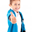 Adorable kid doing thumbs up over white background — Stock Photo