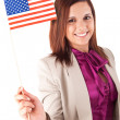 Stock Photo: Beautiful woman holding american flag