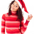 Beautiful african woman celebrating christmas wearing santa hat — Stock Photo