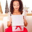 Beautiful african woman with presents — Stock Photo