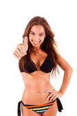 Beautiful bikini woman showing thumbs up — Stock Photo