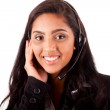 Portrait of a happy young mix race call center employee smiling — Stock Photo #22192459
