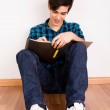 Young man studying at home — Stock Photo