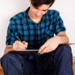 Young man studying at home — Stock Photo #24073557