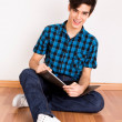 Young man studying at home — Stock Photo #24073559