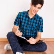 Young man studying at home — Stock Photo #24073571