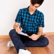 Young man studying at home — Stock Photo #24073575