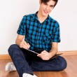 Stock Photo: Young mstudying at home