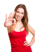 Attractive woman doing OK sign — Stock Photo