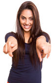 Smiling mix race woman pointing finger forward — Stock Photo