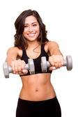 Beautiful fitness woman lifting weights — Stock Photo