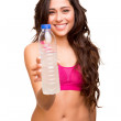 Attractive fitness woman holding a bottle of water — Stock Photo