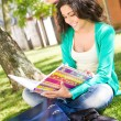 Young student studying at the school garden — Stock Photo #28164783
