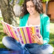 Young student studying at the school garden — Stock Photo #28164805