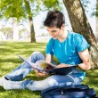 Young student studying at the school garden — Stock Photo