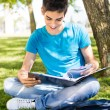 Young student studying at the school garden — Stock Photo #28164915