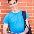 Beautiful young student in campus — Stock Photo
