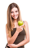 Portrait of a young woman eating green apple — Stock Photo
