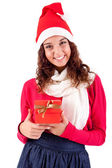 Woman holding a gift for christmas — Stock Photo