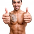 Fit man showing thumbs up — Stock Photo #37298753