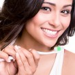 Stock Photo: Womholding tooth brush