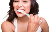 Woman holding a tooth brush — Stock Photo