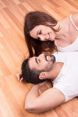 Couple relaxing on the floor — Stock Photo