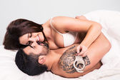 Love couple in bed — Stock Photo