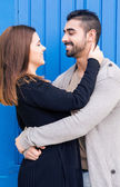 Couple hugging over blue background — Stock Photo