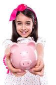 Flicka som håller en spargris — Stockfoto