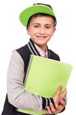 Little student holding books — Stock Photo