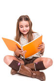 Girl holding a sketchbook — Stock Photo