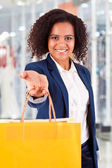 Afro woman holding shopping bags — Stock Photo