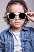 Boy wearing white sunglasses — Stock Photo