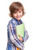 Garoto segurando livros escolares — Fotografia Stock