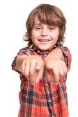 Boy pointing front — Stockfoto