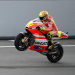 Постер, плакат: Valentino Rossi whelley the superbike during race at Moto GP Sepang Malaysia