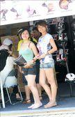 Motor accessories shoplot model durinh Moto GP. Sepang. Malaysia. — Stock Photo