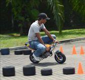 Man ride a small pocket bike during Moto GP Sepang.Malaysia. — Stock Photo