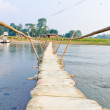 Stock Photo: Handmade bamboo wooden sand bag bridge in ChitwNepal