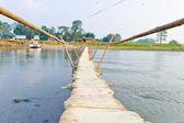 Handmade bamboo wooden sand bag bridge in Chitwan Nepal — Stock Photo