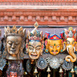 Traditional Buddhist festival masks on a shop window — Lizenzfreies Foto