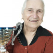 Isolated old smiling lady with 85. years trophy on white background - Stock Photo