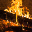Burning-firewoods-ember-in-fireplace — Stock Photo
