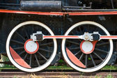 Two wheels view of old fashioned steam locomotive — Stock Photo