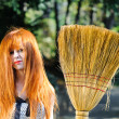 Untidy red haired cute young girl holding broom — Stock Photo