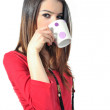 Isolated beautiful young girl drinking coffee by mug on white background — Stock Photo