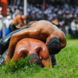 Two wrestlers oil wrestling Turkish yagli güres in Kirkpinar Edirne — Stock Photo
