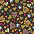 Motley hearts seamless pattern — Stock Vector